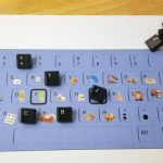 A picture of using old keyboard keys and a keyboard template to play a game.